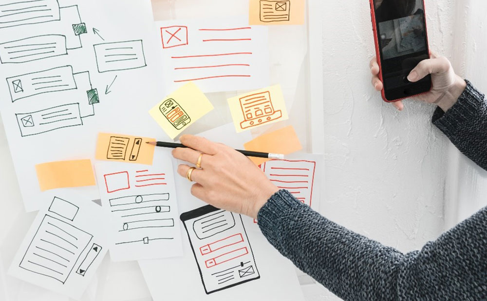 UX designer creating wireframes to validate the design process